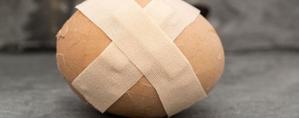 Band Aid on broken egg